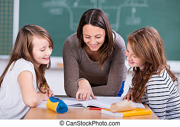 Learning students - Happy teacher teaching her two students...