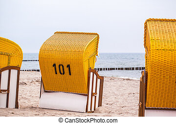 yellow beach chairs standing on the beach