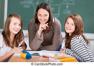 Cheerful teacher with students