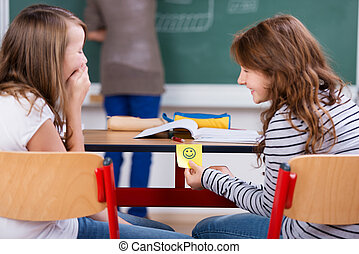 Laughing students - Young students laughing and holding...