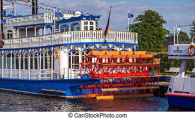 nostalgic steamboat - red water wheel of an old steamboat