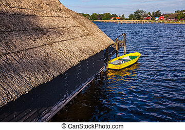 yellow rowing boat at a jetty
