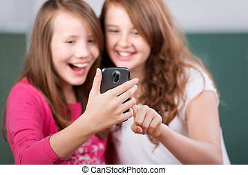 Laughing students - Two laughing students looking at the...