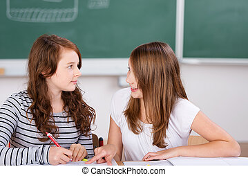 Talking students - Two cheerful students talking while...