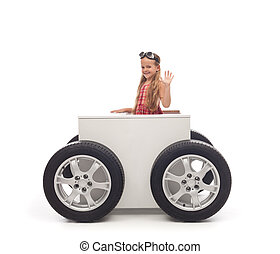 Travel concept with little girl and wheeled box