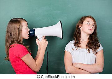Girl trying to make herself heard with a megaphone -...