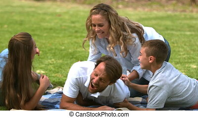 Happy family playing together in a