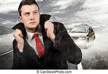 Failure - Businessman walking trough the rain after car...