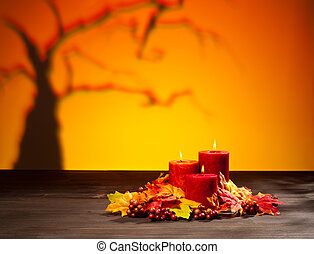 Candles in scary Halloween landscape with dry tree