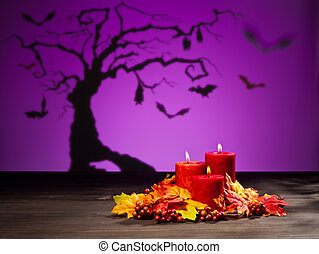 Candles in Halloween setting - Candles in scary Halloween...