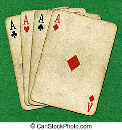 Four old aces. - Four old vintage dirty aces poker cards on...