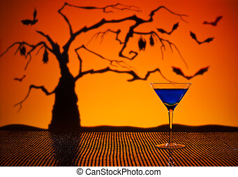 Cobalt Martini in Halloween setting with bats and a tree