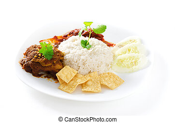 Nasi lemak traditional malaysian spicy rice dish. Served...