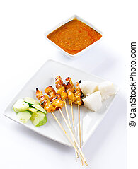 Chicken satay or sate, skewered and grilled meat, served...