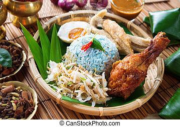 Nasi kerabu or nasi ulam, popular Malay rice dish. Blue...