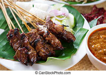 sate - Satay or sate, skewered and grilled meat, served with...