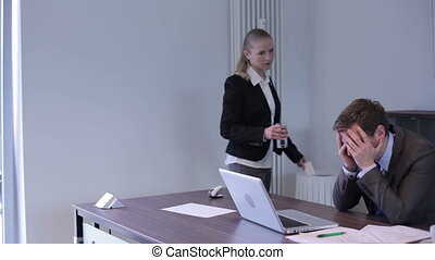 Despair in the office - Busnessman sitting in his office and...