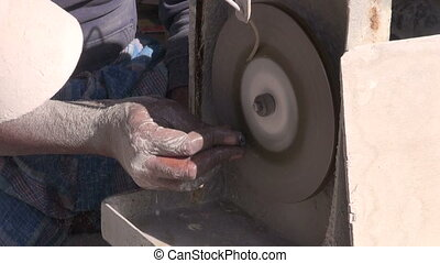 indian craftsman grinding stone