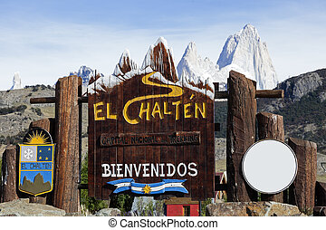 Welcome to El Chalten sign Fitz Roy seen in the background