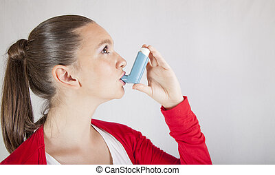 Cute girl with asthma inhaler - Cute girl using an asthma...