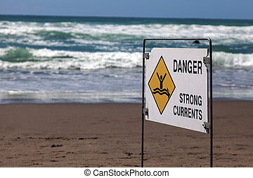 Danger - strong currents Sign seen on the beach in New...