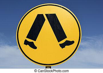 Pedestrians - round yellow sign seen in Australia