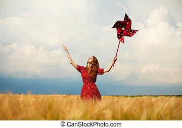 Redhead girl with toy wind turbine
