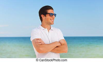 Handsome young man at beach background