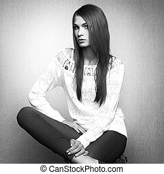 Photo of beautiful young woman in white jacket