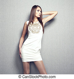 Fashion photo of young sensual woman in beige dress
