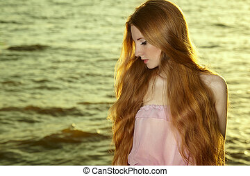 Beautiful redhead girl at pond. Beauty summertime