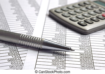 finance business  calculation with pen and calculator