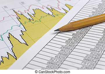 finance business calculation with pencil on chart