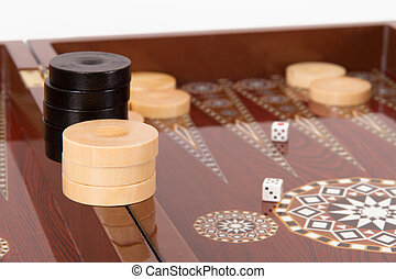Backgammon chips and dice on table.
