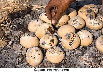 Indian bread baking on the coals Pushkar, Rajasthan, India