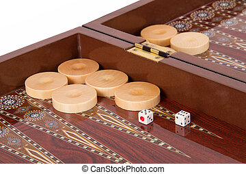 Backgammon table, chips and dices with five and six.