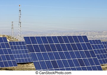 solar energy - huge photovoltaic panels and pylon