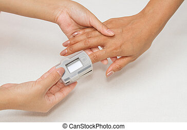 Patient with pulse oximeter on finger for monitoring