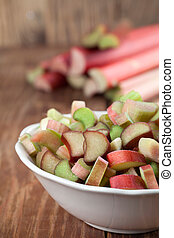 Rhubarb - Fresh rhubarb on wooden background. Shallow dof