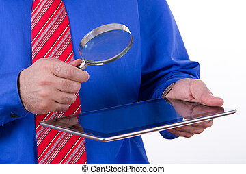 Businessman Holding Magnifying Glass and Tablet -...