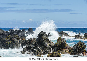 Maui coastline with blue skies and lava rocks