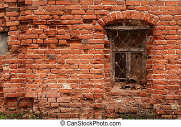 Window of the old brick house close up