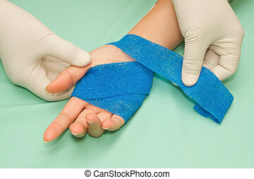 Wound dressing apply medicine bandage on hand injury