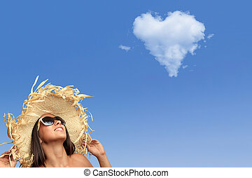 woman with heart shaped cloud - Beautiful young woman...