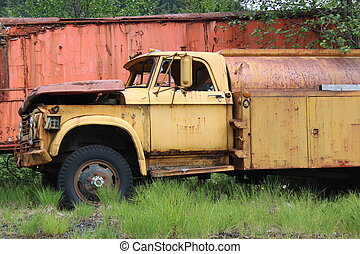 Rusty Old Industrial Truck - Rusty abandoned old yellow...
