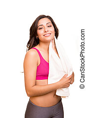 Attractive fitness woman posing with gym towel