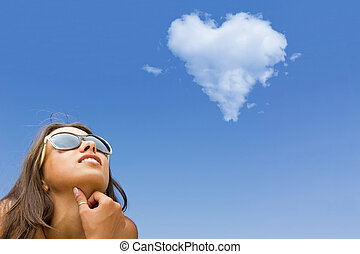 woman with heart shaped cloud - Beautiful young woman with...