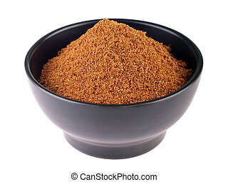 Garam masala powder - garam masala powder on a black ceramic...
