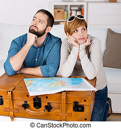 Couple With Map Leaning On Suitcase In House - Portrait of...