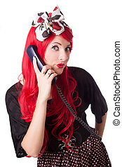 Chocked retro woman with red hair on the phone isolated on...